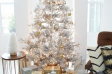 09 metallic decor ideas –  a silver tree with gold and white ornaments and gift boxes wrapped with gold and silver