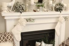 09 neutral mantel decor with silver candle holders and vases, a deer and flocked fir balls