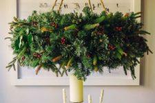 09 oversized evergreen wreath chandelier with pinecones and berries