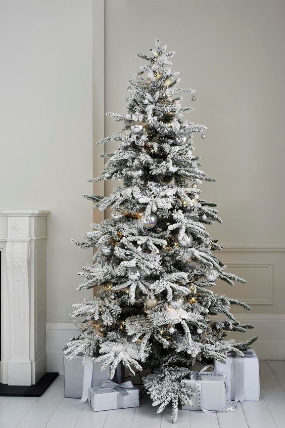 Alaskan fir tree with silver ornaments looks very modern and chic