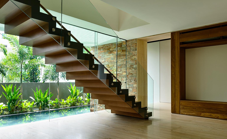 Key materials include limestone, textured concrete, zircon timber, granite, travertine, and tobacco hued cohiba stone