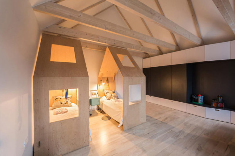 The kids' room is also modern, with sleek wardrobes and house-shaped beds to make the space cozy and private