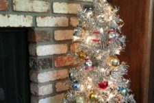 10 aluminum Christmas tree with bold vintage ornaments and ornaments displayed in the crate