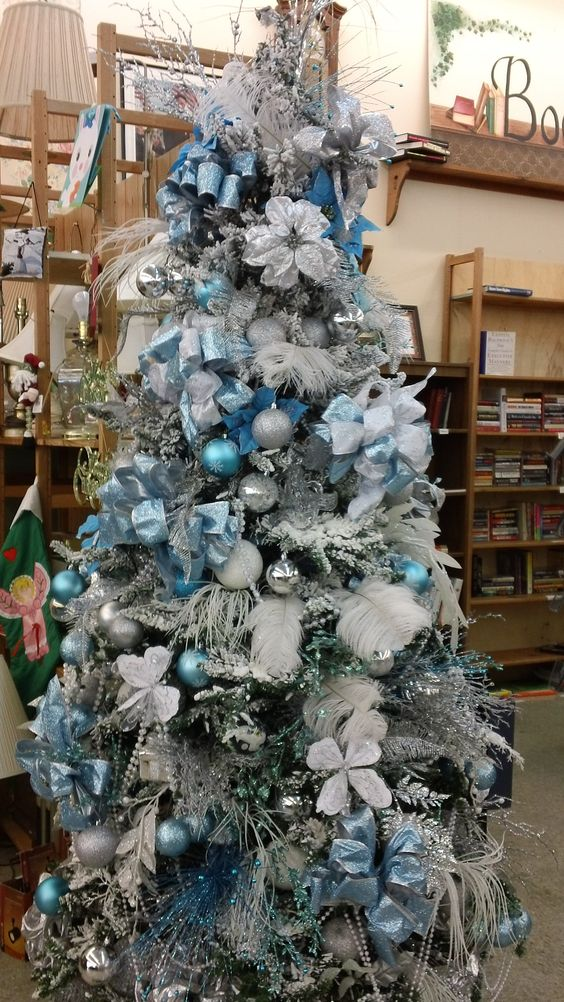 white christmas tree with silver and blue decorations photo4