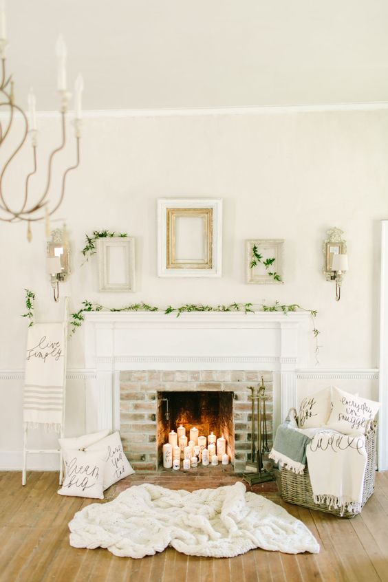 foliage garland, candles in a non-working fireplace and blankets in a basket