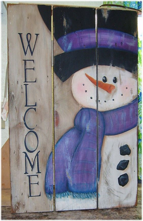 handpainted snowman sign on reclaimed wood