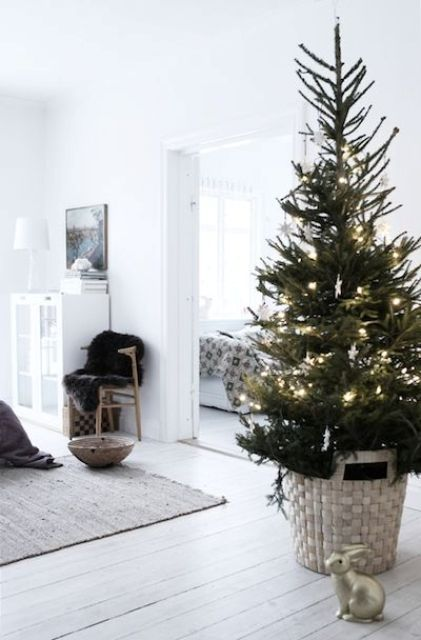 modern Christmas tree with lights in a basket