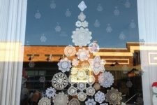 10 paper snowflakes attached to the window
