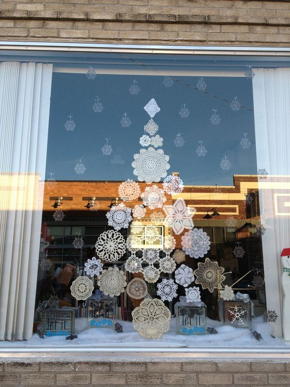 paper snowflakes attached to the window