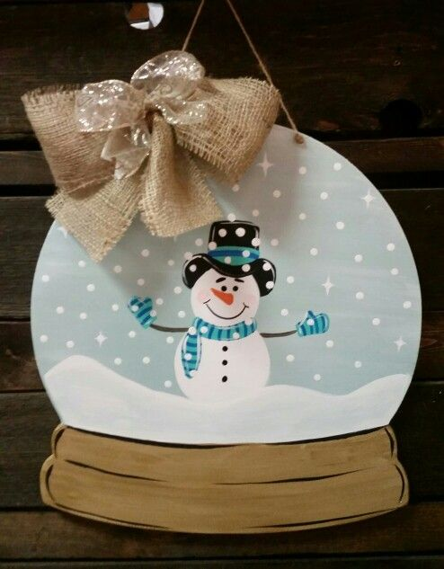 snow globe door hanger with a burlap bow