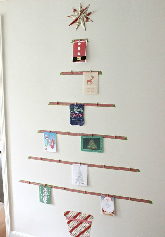 tree-shaped card display on the wall is a great idea to sort them all