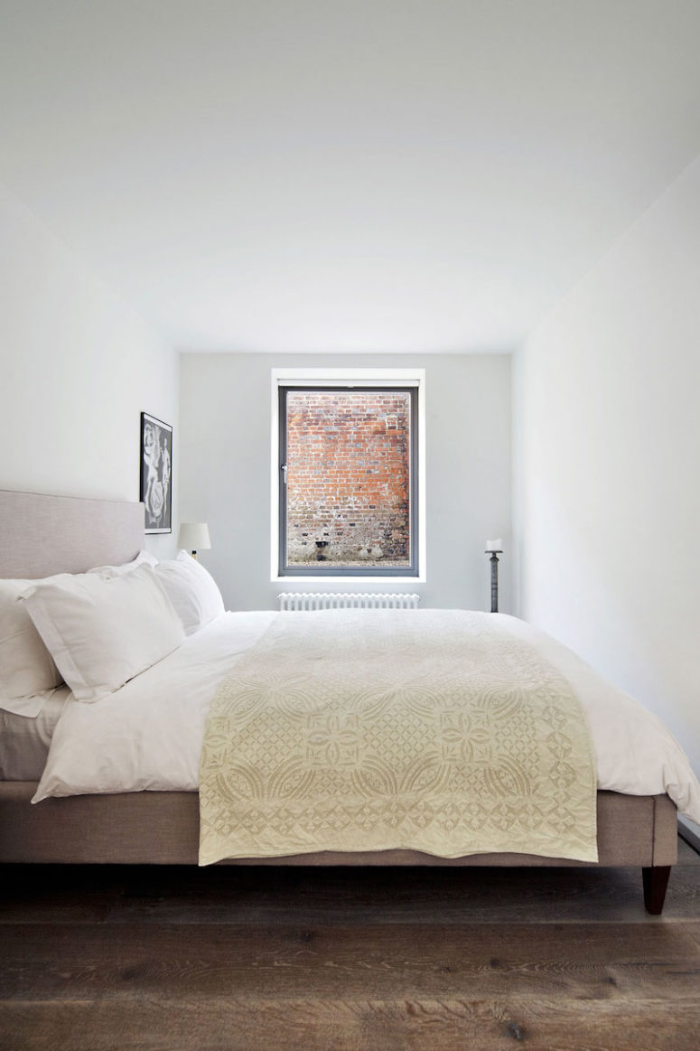 The bedroom is serene, simple and comfortable
