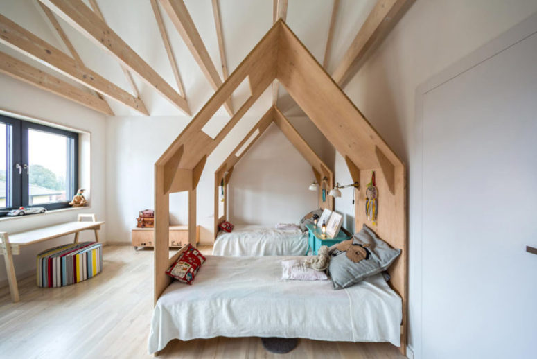 Wooden beams and light wood on the floor make the room cozier