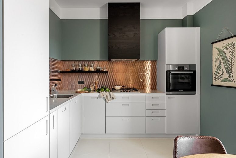 sleek contemporary kitchen with a sparkling copper penny tile backsplash