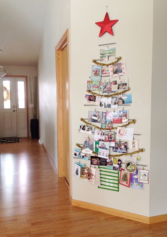 tree-shaped Christmas card display on the wall