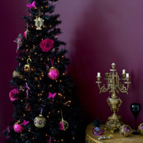 a dramatic, glam and burlesque black tree with rose and bauble ornaments