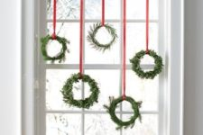 12 an assortment of small evergreen wreaths with red ribbon