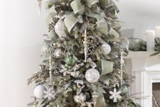 12 darker silver tree decorated with olive green ornaments and fabric garlands, wwhite and silver ornaments and snowflakes