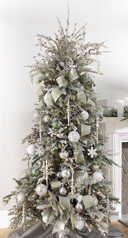 darker silver tree decorated with olive green ornaments and fabric garlands, wwhite and silver ornaments and snowflakes