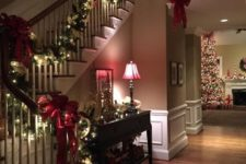 12 evergreen garland with red bows and lights