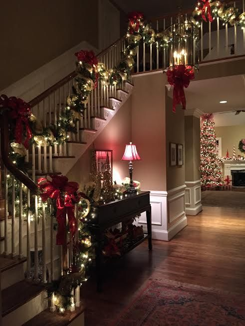 evergreen garland with red bows and lights