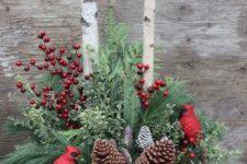 12 winter urn arrangement with pinecones, red berries and cardinals