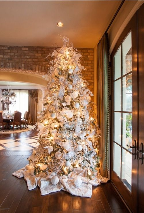 a large christmas tree with white and silver decorations - How To Decorate A Big Christmas Tree