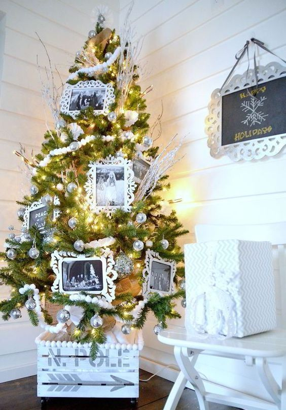 a whitewashed industrial crate looks cool with silver disco balls on the tree
