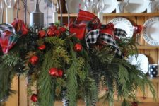 13 cute chandelier with plaid ribbon bows, fir branches and red jungle bells