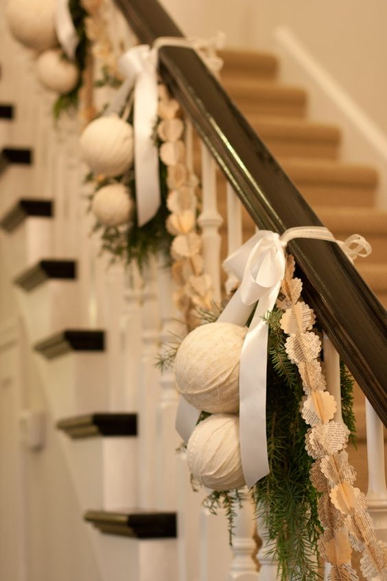 fabric wrapped ornaments, evergreens and bows on the banister