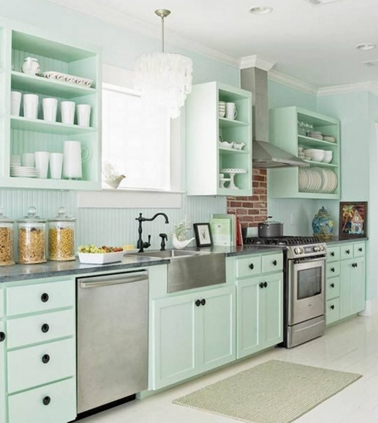 mint-colored backsplash coincides with the color of cabinets
