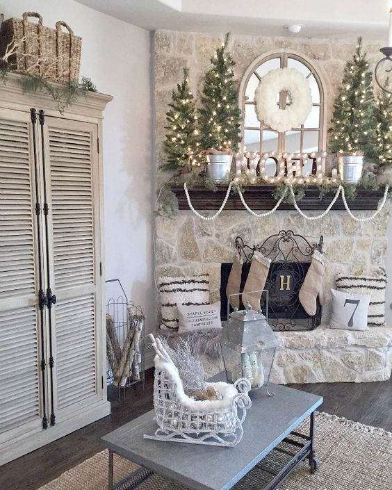 neutral mantel with a marquee and lit up trees