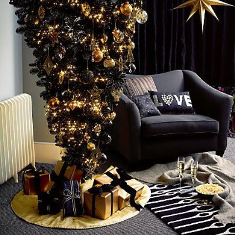 a black upside down christmas tree with black and gold decor