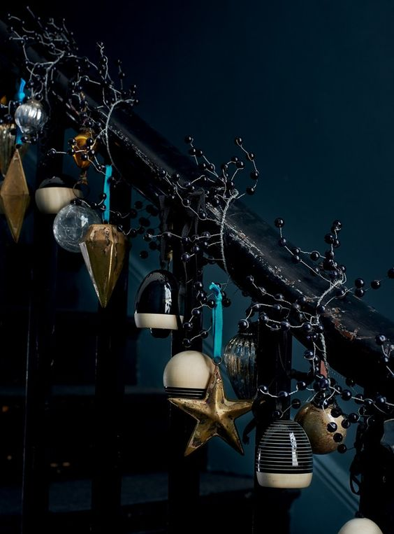 dark Christmas stairs decor with bells, black berries and vintage ornaments