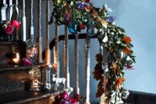 14 faux leaves and flowers with colorful baubles for different staircase decor