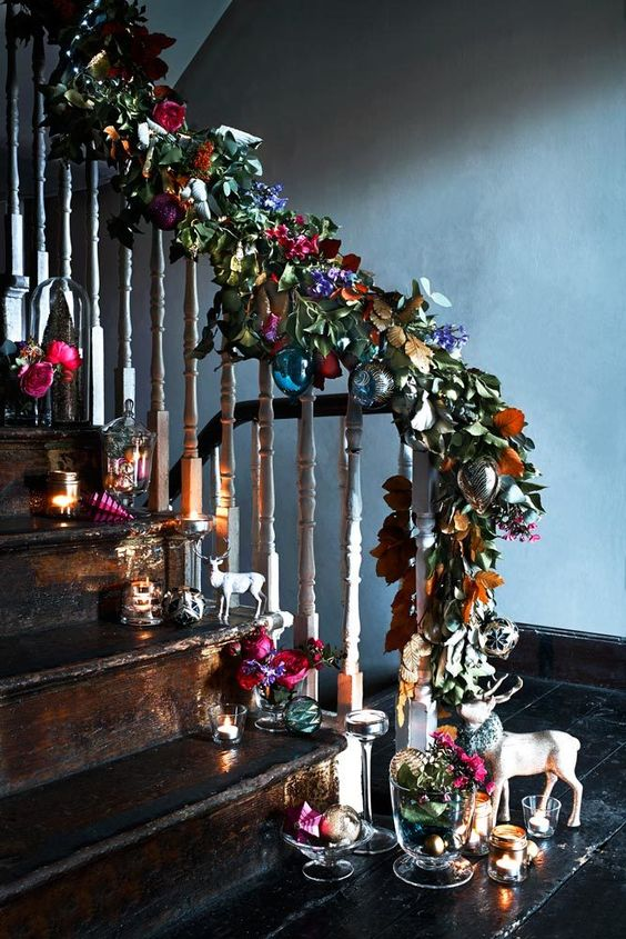 faux leaves and flowers with colorful baubles for different staircase decor
