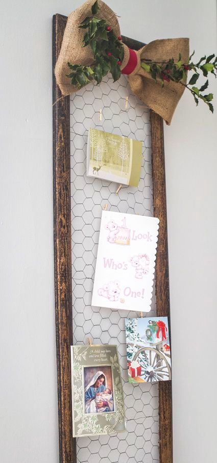 framed chicken wire is a great piece to hang photos and cards
