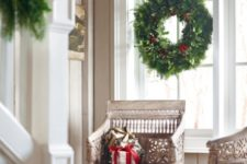 14 lush evergreen wreaths and garlands are a timeless option that fits any interior