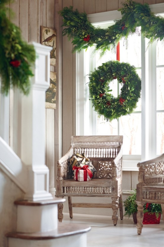 lush evergreen wreaths and garlands are a timeless option that fits any interior