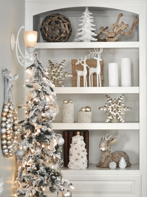 a flocked tree with silver ornaments white and silver decor are soothing - Neutral Christmas Decor