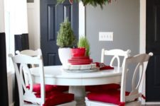 15 evergreen branches and red and white bows