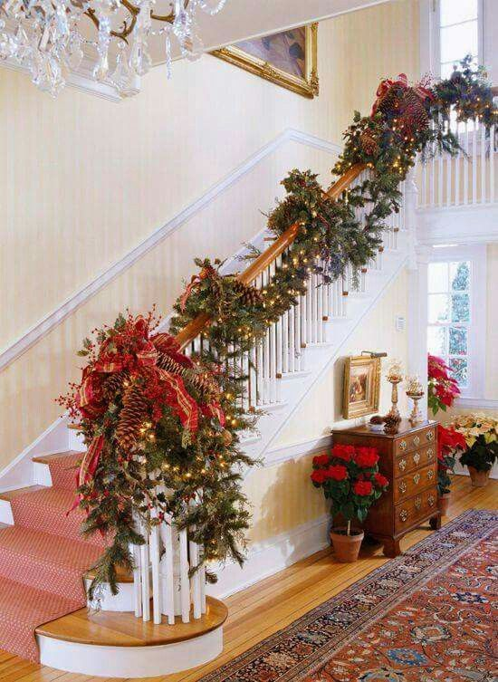 fir garland with large pinecones, lights and red ribbon decor
