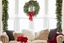 15 lit up fir garland and wreath with red bows