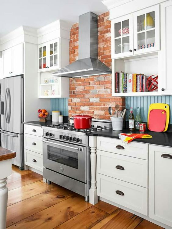red brick, blue beadboard backsplash and white cabinets look cheerful and eye-catching together