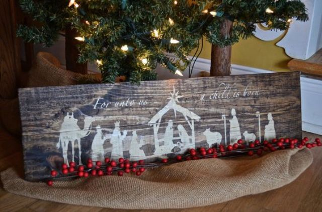 rustic wooden nativity sign made with white paint