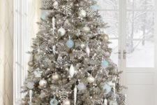 15 stunning silver tree with white, silver and light blue ornaments that reminds of Christmas wonderland