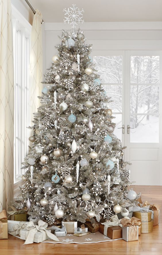 Stunning Silver Tree With White, Silver And Light Blue Ornaments That  Reminds Of Christmas Wonderland