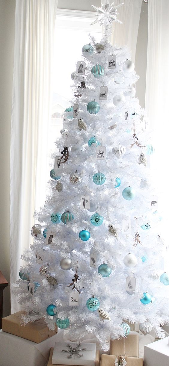 white Christmas tree with turquoise and silver ornaments