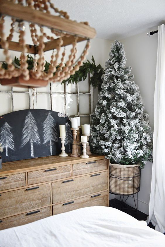 a flocked Christmas tree and trees on a chalkboard can be enough for neutral decor