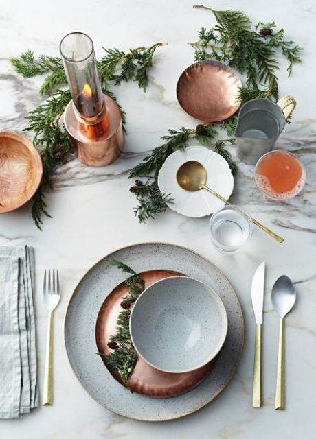 copper chargers, plates and candle holders